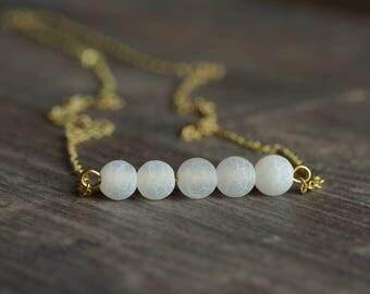 Delicate brass necklace with agate Matt White