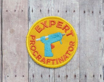Expert Procraftinator Patch, Crafty Merit Badge, Embroidered Yellow Canvas with Glue Gun and Orange Text, Choice of Finding, Made in USA