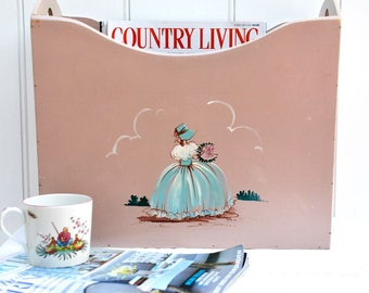 A vintage painted wooden magazine rack with a hand painted crinoline lady, 1930s