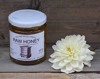 Raw honey in a 227g jar
