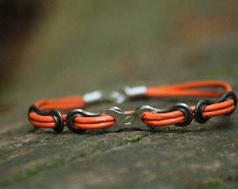 Orange Leather biker bracelet made of an used bike chain