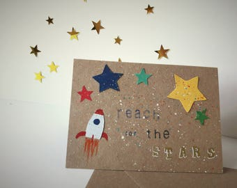 Handmade 'Reach for the stars' card for children, colour stars and rocket, kraft card, splatter, blank inside