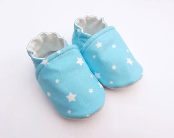 Sole leather baby booties and turquoise blue cotton top with white stars