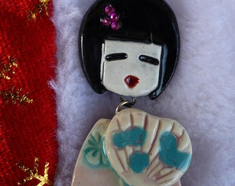 Kokeshi articulated handcrafted ceramic and rhinestone necklace
