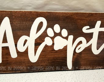 Adopt paw print wooden sign