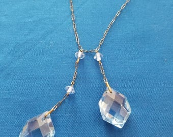 Vintage gold tone necklace with blue glass beads