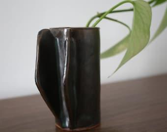 A Black Ceramic Bud Vase