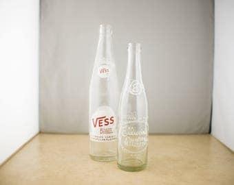 Vess 16 oz. Bottle & Ellwein's Quality Beverages 10 oz. Bottle