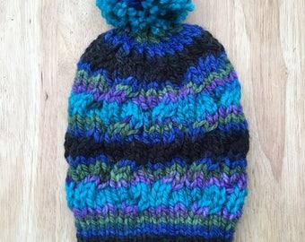 Pom Pom Hand Knit hat with Cable Stitch