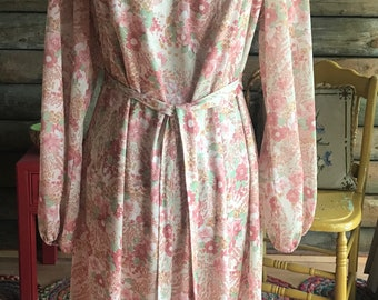 1970s dress in florals of green and dusty pink