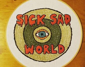 Sick Sad World hoop hanging