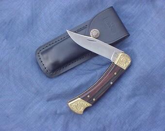 Buck 110 Folding Hunter Knife Hand Engraved Brass Bolsters