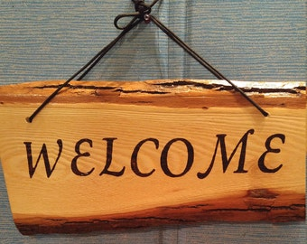 """2 Sided """"WELCOME"""" Indoor/ Outdoor Hanging Sign, Wood Burned, 16.5in x 8in. 60.00"""