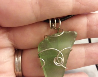 Wire wrapped sea glass pendant.