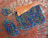 60s tote, eyeglass case + change purse. Eye Popping multicolored plastic bubbles on navy, reverse orange-white. Made in Hong Kong.