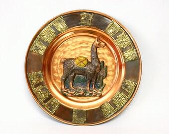 Decorative Peruvian Copper Wall Plate Depiciting Llama with Brass Inca Motif at Border