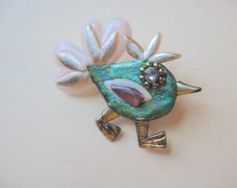 Whimsical bird brooch pin in green, pale pink, gold, and silver