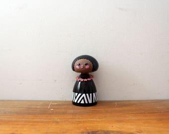 vintage 1970s Avon Small World Colonge 2 oz. Figural Girl Bottle