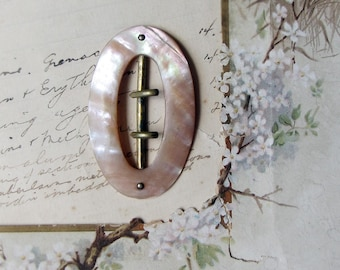 mother of pearl dress buckle - antique oval shell and brass double spike sash buckle - Victorian Edwardian - vintage fashion restoration
