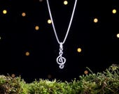 Sterling Silver Tiny Treble Clef - Music Note - (Charm, Necklace, or Earrings)