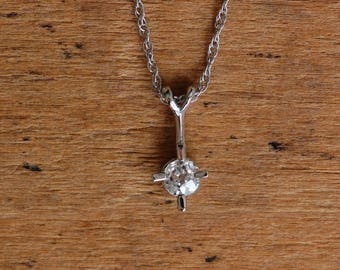 Vintage 14K diamond solitaire pendant with .25 carat Old Miner Cut