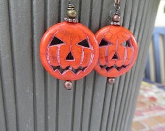 Pumpkin or Jack o Lantern Earrings Handmade Dyed and Carved Stone Earrings Orange and Copper Smiling Kinda Scary Pumpkin Earrings Halloween