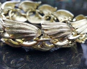 Lisner Vintage Stamped Winged Gold Tone Wide Bracelet