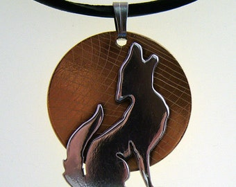 Howl - sterling silver and brass pendant