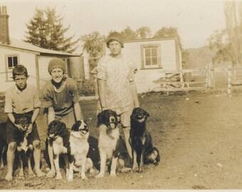Children with five farm dogs, vintage photograph c1930s