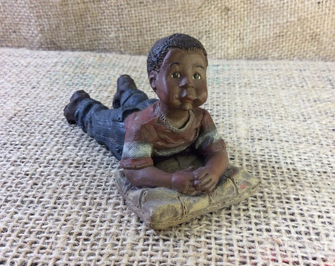 Vintage Sarahs Attic cutie, Sarah's Attic black heritage collection, Sarah's Attic 2228, little boy laying on the floor collectible figurine
