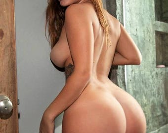 Naked busty curvy brunette model with 32D Breasts