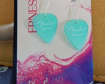 Fender Guitar Pick Earrings,Seafoam Green - Teal - displayed on vintage album art