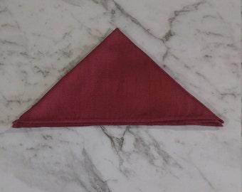 The 'Rhett' pocket square in berry