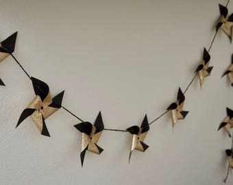 Garland of windmill embossed in black and gold glitter paper