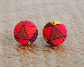 Handmade geo triangle fabric button earrings in warm red, orange and yellow tones. Hypoallergenic steel posts.