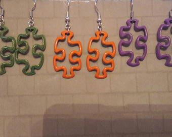 Hand enamelled jigsaw piece earrings.