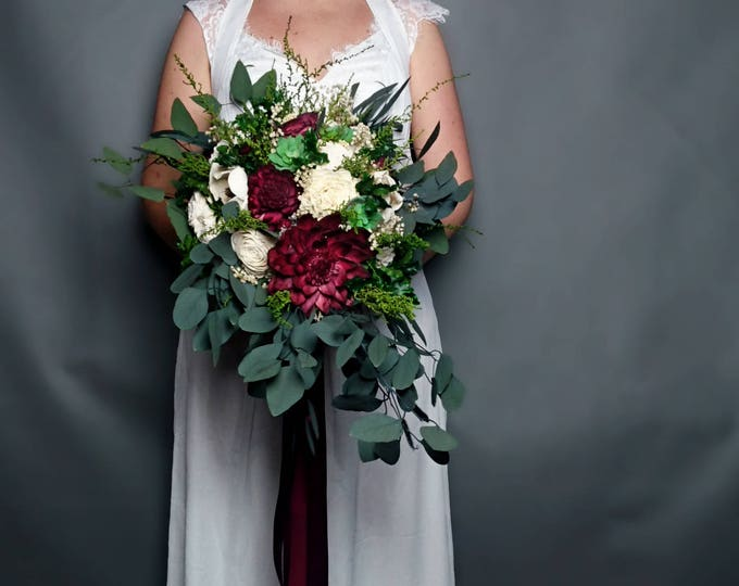 Deep wine wedding bouquet with preserved greenery and long ribbons