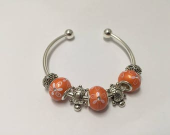 Bangle charm's orange with tortoises ref 514