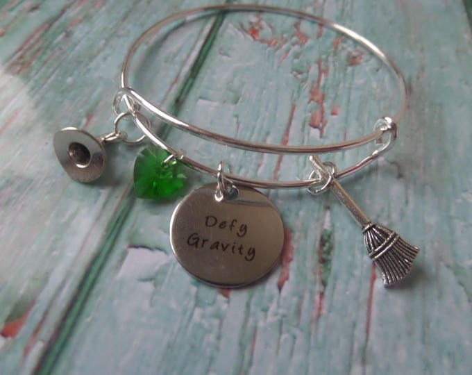 """WICKED Inspired silver tone 20mm laser tag """" defy gravity """"  65mm expandable bangle witches gift jewellery Uk"""