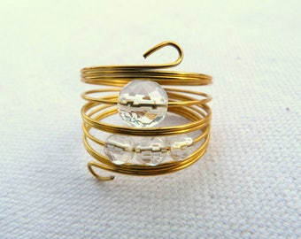 Steel ring and faceted natural stones
