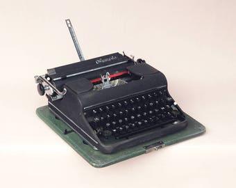 Vintage typewriter OLYMPIA black box 1940 1950 typing, writing, literature, best seller mid century
