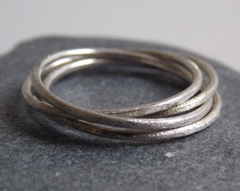 4 interlaced rings made of silver with a sandblasted effect