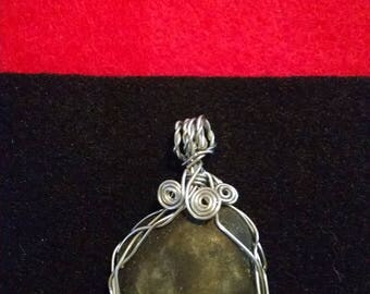 Elegant black and silver wire wrapped pendant