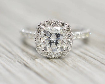 Cushion Brilliant in a French Pavé Cushion Halo Engagement Ring in White
