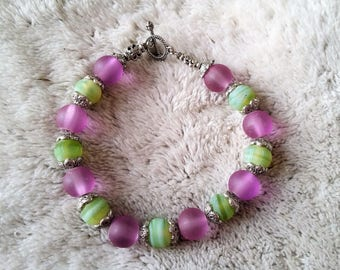 Purple and lime green glass beaded bracelet