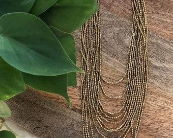 antiqued gold beaded necklace   multi strand