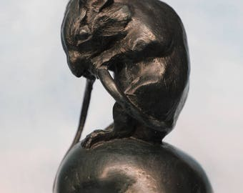 Cast Bronze resin sculpture; mouse holding tail sitting on apple