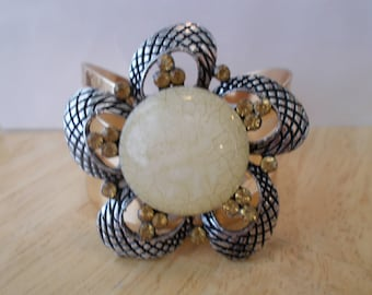 Gold Tone Cuff Bracelet with a Silver Tone, Gold Rhinestones and Cream Glass Flower Brooch Center