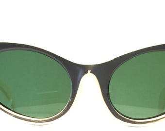 Vintage cat eye sunglasses. 1950's. Rhinestones and engraved designs. Cut outs on sides. Soft grey on white. Green lenses. Hip Cool Women!