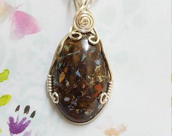 Boulder Opal  Pendant. Wire wrapped Queensland boulder opal beauty.